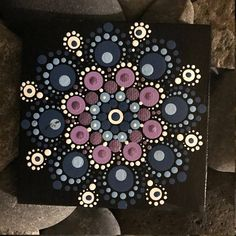 For sale is a hand-painted Mandala on a 4x4 canvas. Painted with high-quality acrylic paints, with a gloss acrylic finish for protection. Colors in this Mandala are Blue and Purple. Each one is hand made and no two are alike