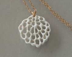 Wapa via Etsy::  Alice's flower - porcelain and gold-filled necklace. Organic floral pendant. Designed and created by Wapa Studio.
