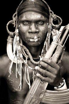 mursi warrior / omo valley by abgefahren2004, via Flickr   African Portraits by Mario Gerth