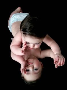 Great idea to photograph a baby. Use a black background and put the baby on a mirror.