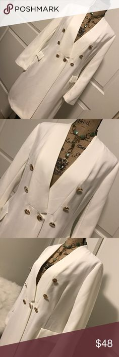STYLEWE BLAZER White Long Button Front Gorgeous !! BRAND NEW NEVER WORN WITH TAGS. This is a white fully lined long polyester blazer featuring a v-neck with gold button front. Two front pockets. So stylish. A nice way to bring in the fall season. Perfect for your weekday office wear or add some pearls and heels for that special occasion. Stylewe Jackets & Coats Blazers