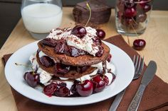 Black Forest Pancakes  Ingredients 1 cup flour 1/4 cup unsweetened cocoa powder 1/4 cup sugar 1/2 teaspoon baking powder 1/2 teaspoon salt 1 cup milk 1 egg 2 tablespoons butter, melted 1 splash kirsch (optional) 2 cups cherries, pitted and halved 2 tablespoons sugar 2 teaspoons corn starch 1/4 cup water 1/2 cup whipping cream 2 tablespoons sugar