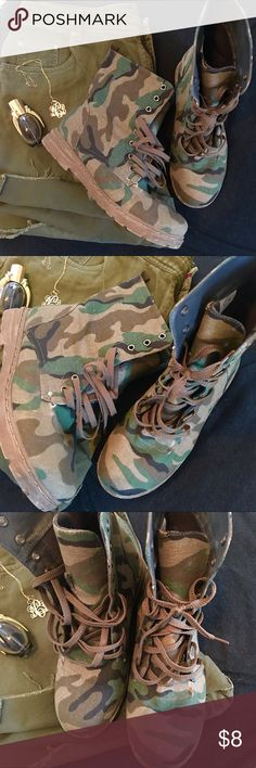 Camouflage Boots Preowned  Fashion boots In pic 4 you can see where the boot fabric has started to tear. Because of this I have listed the boots at a reduced price.  Wide feet friendly  Sorry no holds, trades  Bundle and save! Shoes Lace Up Boots