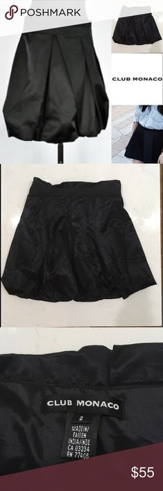 CLUB MONACO BLACK POLYESTER A-LINE BUBBLE SKIRT. PREVIOUSLY OWNED: EXCELLENT CONDITION: ONLY WORN ONCE. GROSGRAIN RIBBON WASTE DETAIL. ZIPPER. LINED. 18 INCH LENGTH. SIZE 2 Club Monaco Skirts Mini