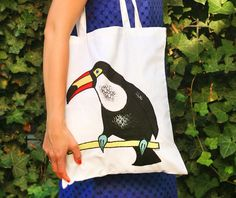 Cotton bag with appliquéed and painted toucan  by SkadiaArt
