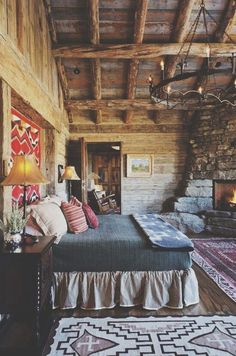 love linens, rugs fireplace in bedroom.