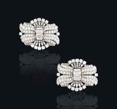 A PAIR OF MID-20TH CENTURY DIAMOND CLIP BROOCHES, BY BULGARI