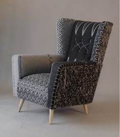 I love this chair. I love the idea of doing this. I know it's not cost effective to upholster. I like that it's neutrals in an interesting way that would work with a grey chesterfield, sort of a understated statement chair. Couch Furniture, Funky Furniture, Furniture Design, Chair Upholstery, Upholstered Chairs, Deco Ethnic Chic, Latest Sofa Designs, Wooden Sofa Set Designs, Mid Century Armchair