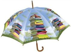 An umbrella decorated with books. No dedicated bibliophile lets a little rain stop them from reading!