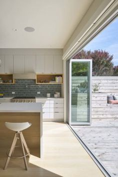 Modern and Chic kitchen, opening to a Sun patio!