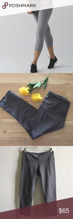 Lululemon Wunder Under Crops Lululemon dark gray Wunder Under crops.  Barely worn.  Very mild pilling in crotch area.  Designed to fit like a second skin.  Perfect for yoga or the gym.  Hidden key pocket.  In excellent condition. lululemon athletica Pants Ankle & Cropped