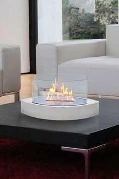 Lexington High-Gloss White Tabletop Fireplace. I could just stare at that! What!? Mini fireplace?! So cool