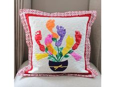 Rachael Rabbit shows the special Mother's Day pillows that she helped her kids make for their grandmother.  (Mother's Day in the UK was celebrated last week.)  One has a bouquet of handprints, the other a bouquet of footprints.  tutorial: http://rachaelrabbit.blogspot.com/2013/03/mothers-day-pillows.html