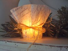 coffee filter votive cover: stamp and tie with ribbon/raffia (link sends  you nowhere...but you get the idea)