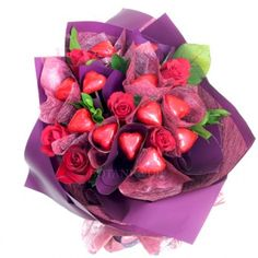 Edible Blooms bouquet of 12 Heart Chocolates and 6 Red Roses for Gold Coast Delivery.