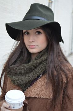 Our model is enjoying her coffee and looks great in her floppy fedora hat, cozy scarf and faux sherpa coat at JONDIE.