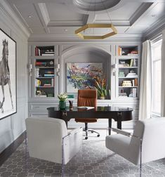 50 Home Offices That Maximize Creativity This grand home office beautifully blends old and new with traditional mouldings and an impressive desk, juxtaposed by a pair of modern, Lucite-framed chairs. Home Office Space, Home Office Decor, Home Decor, Office Ideas, Office Spaces, Work Spaces, Office Interior Design, Office Interiors, Modern Office Design