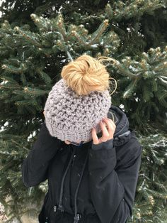 The current turnaround time for hats is 6 - 8 weeks. Thank you so much for all the love. The elves and I are working as quickly as we can to get your order to you. This made to order messy bun hat was inspired the woman who can rock any bad hair day with style! This ponytail hat is perfect for wearing every day and has an elastic band at the hole to pull your hair through with ease without leaving a lot of open space at the top. The hole is large enough to pull your bun right through it…