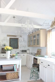 French Cottage Kitchen. Uh-Mazingggg!!!! Love the island, chandelier, curtains, beams, muted colors, all of it...