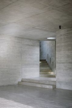 Treating the concrete form as a carved-out, cave-like space, the living spaces are divided internally by brickwork walls. Concrete Forms, Concrete Houses, Concrete Design, Concrete Wall, Beautiful Architecture, Contemporary Architecture, Modular Housing, Concrete Interiors, Open Staircase