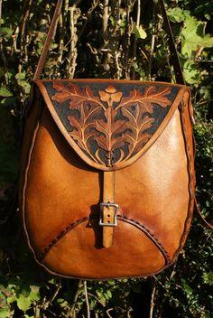 sturdy weatherproof full leather man bag with oak leaf carving design