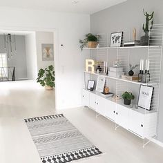 grey minimalistic rug, string pocket shelf, string shelves, string shelf living room, string shelves living room ideas for modern minimalist entrepreneurs Furniture, Room, Interior, Interior Inspiration, Home, House Interior, Interior Design, Furniture Design, Shelving