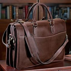 Tusting Briefbag with Laptop Sleeve: The rich Tusting leather mellows with age, acquiring that comfortably worn-in look, as if you've owned them forever. Some variations may occur in coloring, as the leather is finished by hand using an age-old process.