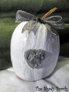 White Painted Pumpkin with a Glittery Pipe-cleaner Heart of Silver