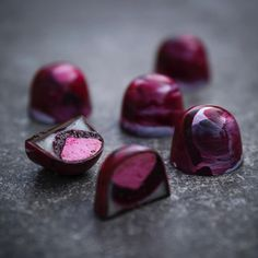 Bonbons by JN Chocolate - black currant bonbon filled with marchmallows and pate a fruit of currant and lemon ganache. Photo by David Back