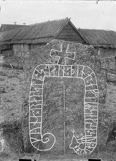 "Rune stone, Jursta, Södermanland, Sweden. The inscription says: ""Gynna raised this stone in memory of Saxe, Halvdan's son"". Behind the rune stone is a farmstead. Photo taken around 1900."