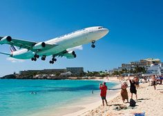 Maho Beach, St. Maarten.  This is not photo-shopped-- this is real.  The airport is feet from the beach.  So fun!! Held on to the fence too!