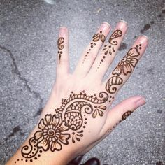 Don't really like the art,but i love how it starts at the finger and goes back past the wrist,also i like how every finger has a little something on it. Henna tattoo