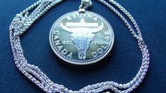 """Item specifics   Seller Notes: """"1982 Canada Regina Cowboy Proof Silver Dollar Pendant 30"""" Pure .925 Silver Chain. Regina Centennial, 10 year warranty. About a 36mm diameter.""""       Circulated/Uncirculated:   Proof   Type:  ..."""