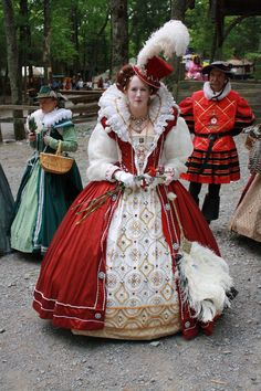 Her Majesty Queen Elizabeth I with Guard and a couple of her Ladies. Beautiful Renaissance Fair costumes.
