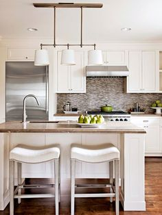 33 Neutral Kitchen Designs You'll Love | DigsDigs. Don't like the stools or the island but do like stool-storage idea as past of the island. Good for smaller kitchen.