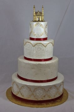 Regal white, gold and red wedding cake.