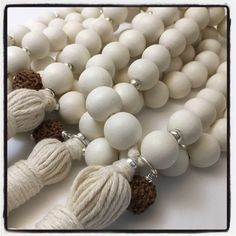 Goldenmean accessories for your home!White Wooden Bead Mala for home decor.  The use of the Fibonacci Sequence in the beading pattern facilitates the presence of balance, harmony and beauty wherever it is present.White Wooden BeadsSterling SilverBlessed Rudraksha SeedsPeace of mind. Clarity. Prosperity. Neutralizes negativity. Stabilizing. Elevates the soul. While supplies last, all Rudraksha used by iSOLA has been blessed by Amma, (the Hugging Saint).