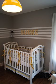 Yellow and Grey Nursery with a cool chandelier. Loving the bold look!