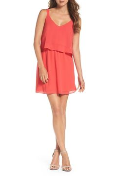 A flowy popover eases the look of this vibrant party dress that's ready for a twirl on the dance floor.