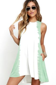 Sweet and sassy, the RVCA Sucker Punched Sage Green Tie-Dye Swing Dress packs a stylish punch! Soft and stretchy jersey knit (with an ivory and sage green tie-dye print) shapes this sleeveless, swing dress with a high neck and side seam pockets. Logo tag at hem.