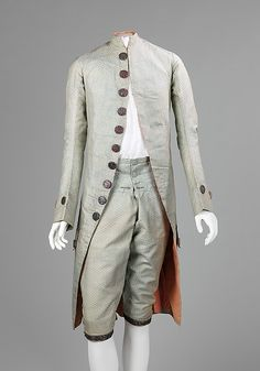 """Suit, 1765-75, French, silk, metal and cotton. """"The distinctive buttons on this 18th-century suit characterize the flamboyance with which French men dressed to match the opulence of their female counterparts. The liberally applied buttons would have been a lively pink color and glittering in candlelight next to the elegant textile and salmon-colored lining."""""""