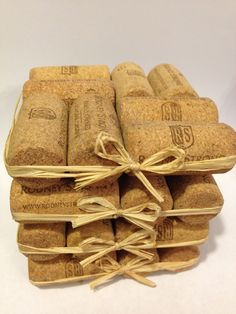 Recycled Wine Cork Coasters with Raffia Bows  Find it Here: https://www.etsy.com/listing/168017942/recycled-unused-wine-cork-coasters-set?