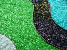 This is fast becoming popular in gardens--- Tumbled Glass Mulch--no sharp edges.  So cool!