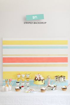 DIY Striped Backdrop | Photography: Ruth Eileen - rutheileenphotography.com  Read More: http://www.stylemepretty.com/living/2014/08/12/banana-split-cake/