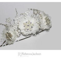 'POLLY' Bridal / Wedding, Side Tiara, Bespoke by Rebecca Jackson.    This gorgeous Tiara makes such a pretty statement in the hair. Applique Flowers are sewn on top of chiffon flowers on lace applique. Vintage pearl style Filigrees are hand sewn to the centre of each. Swarovski Crystals and Pea