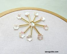 Embroidery Flower 10 easy to do {Bead Embroidery Flower motifs} - Sew Guide - Very easy to make flower embroidery motifs with beads and sequins Bead Embroidery Tutorial, Bead Embroidery Patterns, Hand Work Embroidery, Couture Embroidery, Bead Embroidery Jewelry, Hand Embroidery Stitches, Embroidery Fashion, Hand Embroidery Designs, Embroidery Techniques
