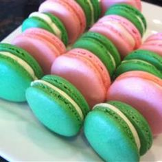 "Macaron (French Macaroon) | ""This recipe is great! I made pistachio macrons so I replaced half of the almond flour with some ground pistachios (very fine) and sifted both flours together. I added green food coloring right before the egg whites reached soft peaks. I even feel like I overwhipped them a bit and they still turned out! I got little ""feet"" and everything. Very nice recipe I will definitely use this one again!"""