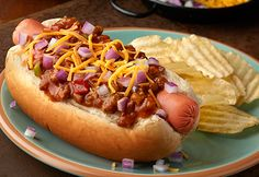 Yourfamily willreally enjoythese tasty chili dogs! No-bean chili, Cheddar cheese and diced onion add great flavor toan American classic. Plus,you can have themon the table in just ten minutes.