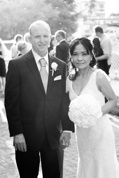 The bride in a White by Vera Wang bridal gown with a fabric flower bouquet and the groom in black and white with a grey tie   http://poppyandjune.com/2015/08/10/real-wedding-jack-pearl/