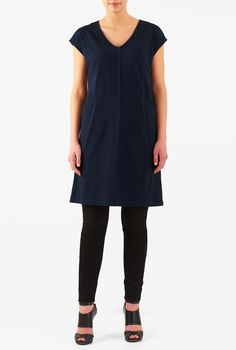 Our cotton jersey knit shift dress is styled with a wide V-neck that tops the faux-front placket.